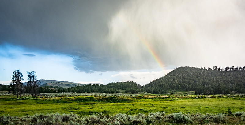 Rain and rainbows in the distance