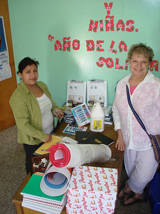 Ann and Professor with the materials purchased for the school.