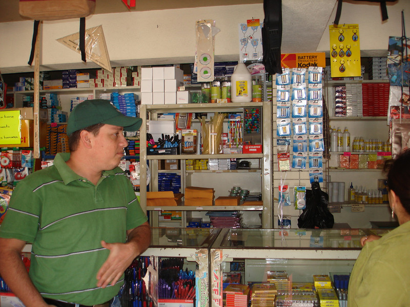 Allen one of the mission employees standing in front of some of the supplies in the store