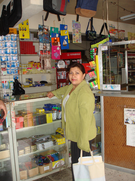 Professor Auxiliadora Pomares at the counter of the libariar (office supply store) here in Jinotega ready to shop.