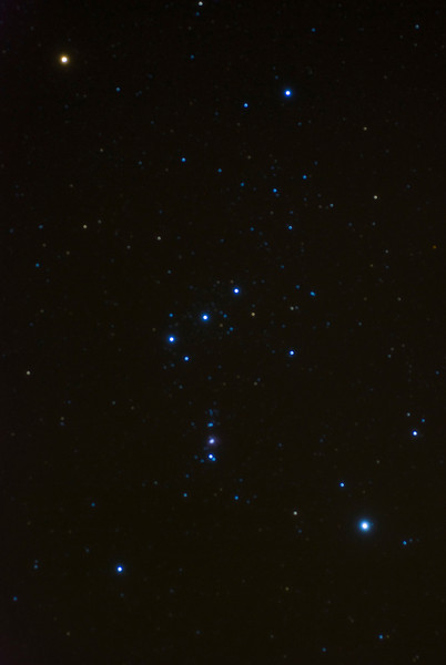 "The constellation Orion. Photograph was taken using a 60mm lens with the camera mounted ""piggyback"" on a refractor telescope using the mounts tracking motor."