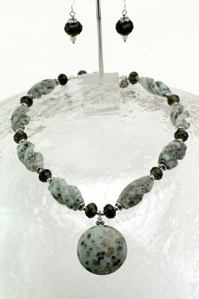 "#14412<br>Sesame agate drop on swirl crystal, pewter and carved sesame agate.<br>Silver plated clasp and 4"" extender chain.<br>Alice Bailey Designs signature tag.<br>Necklace 16"" to 20"" Limited Edition $75.00 ( Originally $125.00)<br>Earrings with sterling silver ear wires $15.00 (Originally $26.00)"