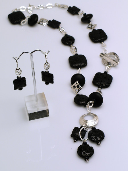 "#12907 <br>Lava rock and sterling silver.<br>Alice Bailey Designs signature tag.<br>Limited Edition. <br> Necklace 24"" Originally $350.00  Now $185.00<br>Earrings with sterling silver French clips Originally $47.00 Now $25.00"