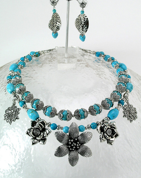 """#30712 <br>Pewter flowers on two strands of magnesite turquoise and pewter.<br>Silver plated clasp and 4"""" extender chain. <br> Alice Bailey Designs signature tag.<br>Necklace 17.5  to 21.5"""" Limited Edition Originally $175.00 Now $$89.00<br>Earrings with pewter and surgical steel posts Originally $26.00 Now $14.00"""