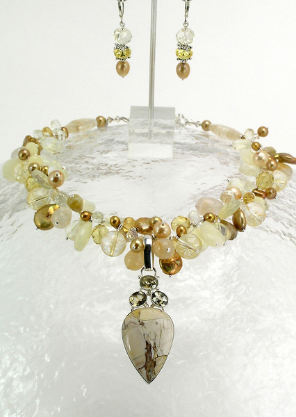 "#18412 <br>Breciated Mookite jasper, topaz and sterling silver pendant <br>on pearls, quartz, citrine, yellow jade, and Swarovski crystal. <br>Topaz and sterling silver clasp and heavy 3"" extender chain.<br>Alice Bailey Designs signature tag.<br> 17"" to 20"" One-of-a-kind.<br> Necklace Originally $650.00  Now $325.00<br>Earrings with sterling silver French clips Originally $55.00 Now $28.00"