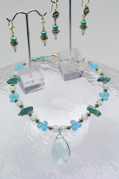 """#17310<br> Wire wrapped aqua crystal briolettes on pearls, <br>glass, bronze and crystal.<br>  Gold plated clasp and 4"""" extender chain.<br> Alice Bailey Designs signature tag.<br>Necklace 16"""" to 20"""" Limited Edition Originally $100.00 Now $55.00<br>Earrings on left not available.<br> Earrings at right with topaz and vermeil gold ear wires  Originally $60.00 Now $35.00"""