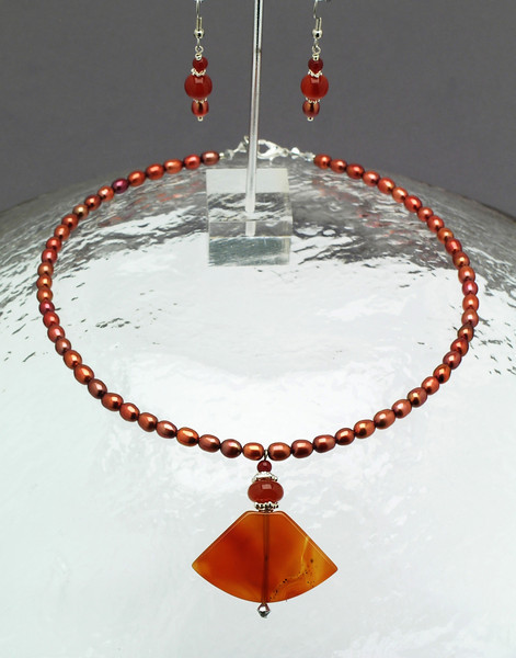 "#17908 <br>Carnelian drop on pearls<br>With silver plated lobster clasp. 17"" Limited Edition. <br>Necklace Originally  $50.00 Now $30.00 <br>Earrings Originally $25.00.Now $15.00"