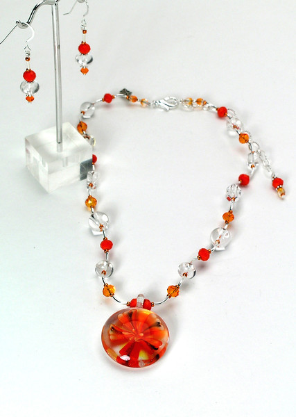 "#21313 <br>Art glass flower drop on clear &amp; faceted crystal <br>and silver plated tubes. <br>Silver plated clasp and 4"" extender chain. <br>Alice Bailey Designs signature tag.<br>Necklace 16""to 20""  Limited Edition Originally  $75.00 Now &amp;39.00<br>Earrings with sterling silver ear wires Originally $27.00 Now $14.00"