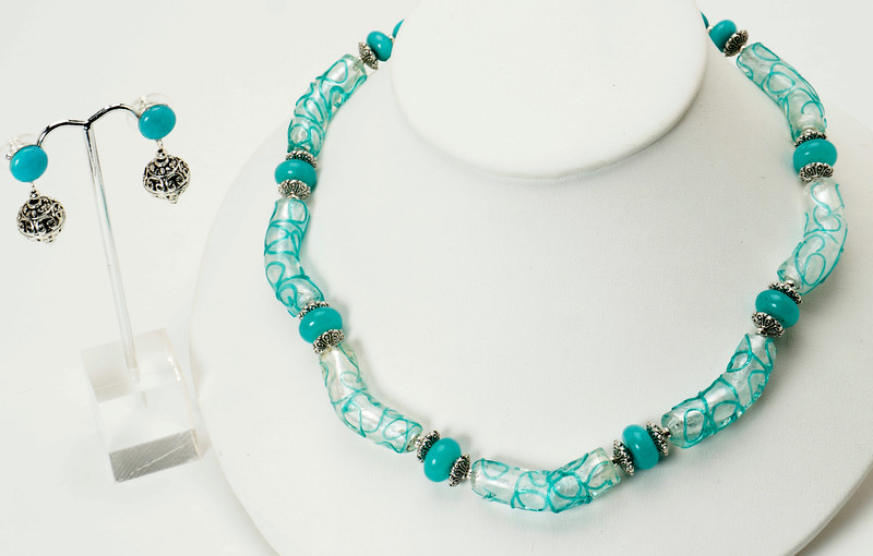 """#10619<br>Turquoise and white lamp glass tubes<br>With Amazonite.<br> Silver plated clasp and 4"""" extender chain.<br>16"""" to 20"""" Limited Edition.<br>Necklace Originally $75.00 Now $39.00<br>Earrings Originally $37.00 Now $19.00"""