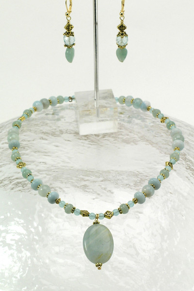 "#10712 <br>Calcite drop on amazonite, green aventurine, aqua marine, blue quartz and bronze. <br>Gold plated clasp and 4""extender chain..<br>Alice Bailey Designs signature tag.<br>Necklace 16"" to 20"" Limited Edition Originally  $65.00 Now $35.00<br> Earrings Originally $27.00 Now $15.00"