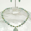 """#10712 <br>Calcite drop on amazonite, green aventurine, aqua marine, blue quartz and bronze. <br>Gold plated clasp and 4""""extender chain..<br>Alice Bailey Designs signature tag.<br>Necklace 16"""" to 20"""" Limited Edition Originally  $65.00 Now $35.00<br> Earrings Originally $27.00 Now $15.00"""