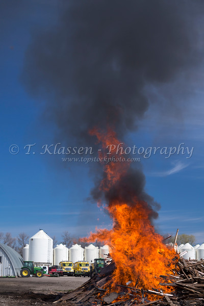 The pink grainery rubble on fire at the Froese farm near Winkler, Manitoba, Canada.