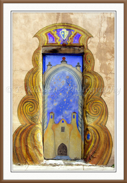 Adobe architecture and an ornate doorway in Santa Fe, New Mexico, USA.