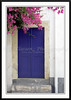 A modern blue door with bougainvillea flowers on the island of Patmos, Greece.