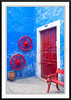 A colorful red door featuring the architecture of Arequipa, Peru, South America.