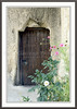 An old wooden door of a home carved into the volcanic rock in the Outdoor Museum in Cappadocia, Turkey.