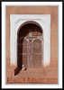 An arched doorway with cat at the Taourit Casbah in Ourzazate, Morocco.