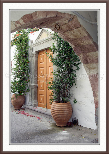 A modern door and archway on a street on the island of Patmos, Greece.