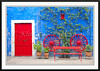 A colorful red doorway featuring the architecture of Arequipa, Peru, South America.