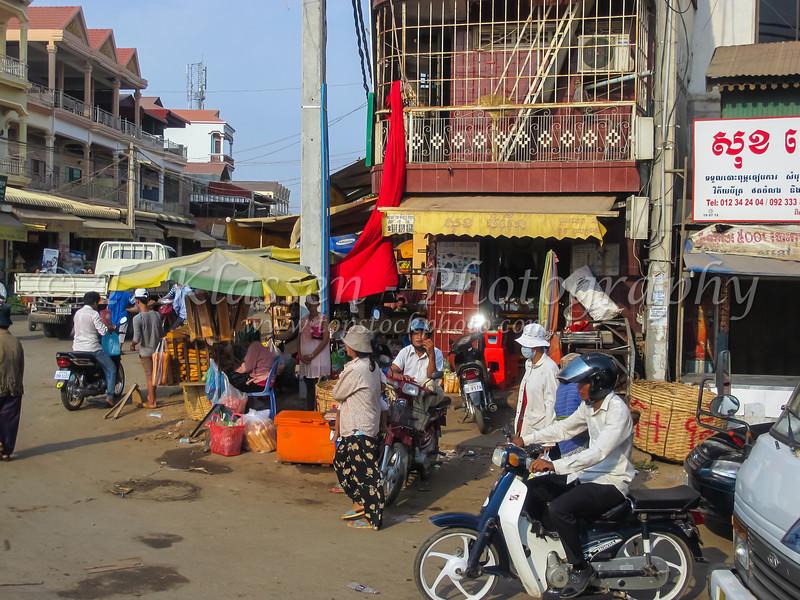 A common street scene with shops in Phnom Penh, Cambodia, Asia.