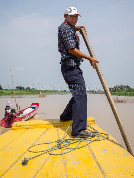 Our capable Gate 1 tour guide Hoy Pheakdey on a riverboat excursion to the floating villages on Tonle Sap, Cambodia, Asia.
