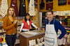 Esther Anne buying a personalized apron in Venice, Italy.