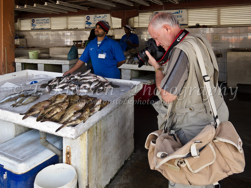 Terry photographing fish in the Fish Market in Sharjah, United Arab Emirates.