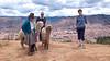 Llamas and a Peruvian couple overlooking Cusco.