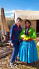 Esther Anne with a young Peruvian girl in ethnic dress on Uros, reed island on Lake Titicaca.