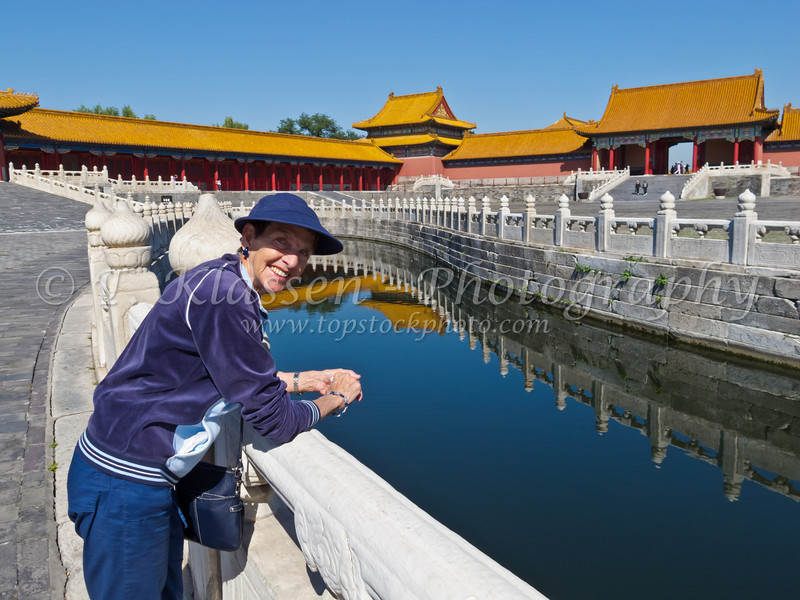 A calm canal with reflections in the Forbidden City, Beijing, China.