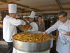 Chefs preparing food on deck of the Costa Deliziosa cruise ship in the Persian Gulf.
