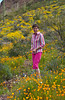 Esther Anne with spring wildflowers, in Organ Pipe Cactus National <br /> Monument, Arizona, USA, America.