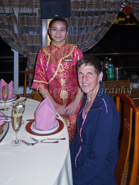 A young Chinese waitress on the Yangtze riverboat in China.