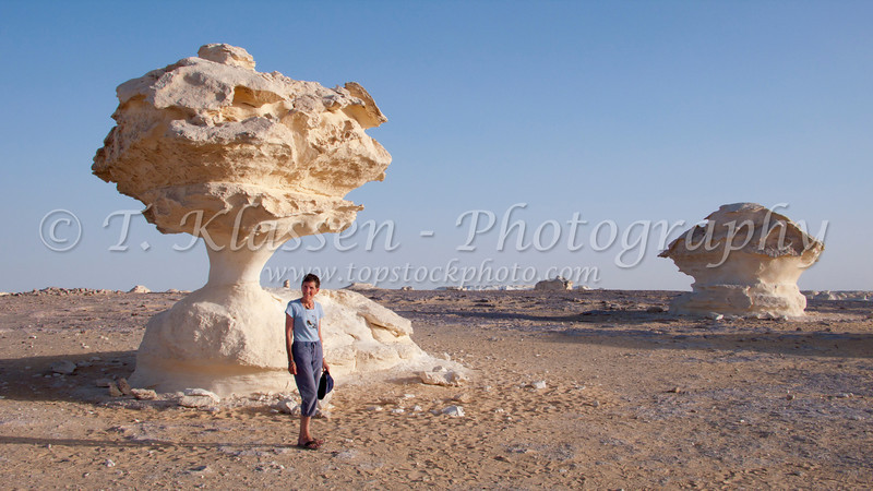 Esther Anne in the White Desert with mushroom shaped formations in Egypt.