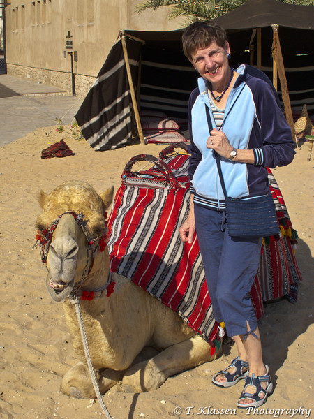 Esther Anne with camel in Dubai, UAE.