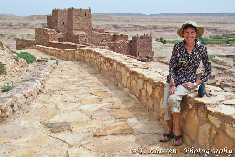 Esther Anne on the pathway leading to the Casbah at Ait Benhaddou near Ourtzazate, Morocco, North Africa.