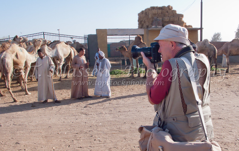 Terry photographing the camel market near Cairo, Egypt.