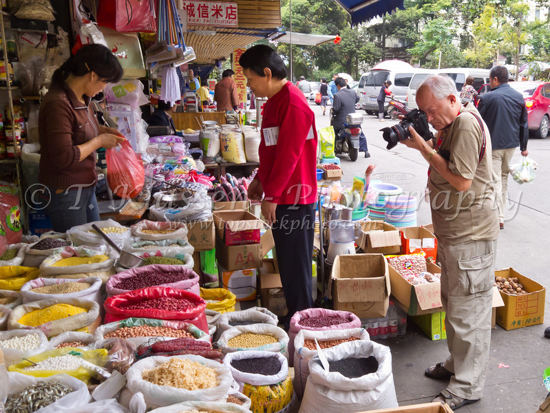Photographing the street market in Shanghai, China.