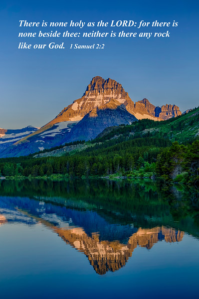 Mount Wilbur reflected in Swiftcurrent Lake at sunrise in Glacier National Park, Montana, USA.