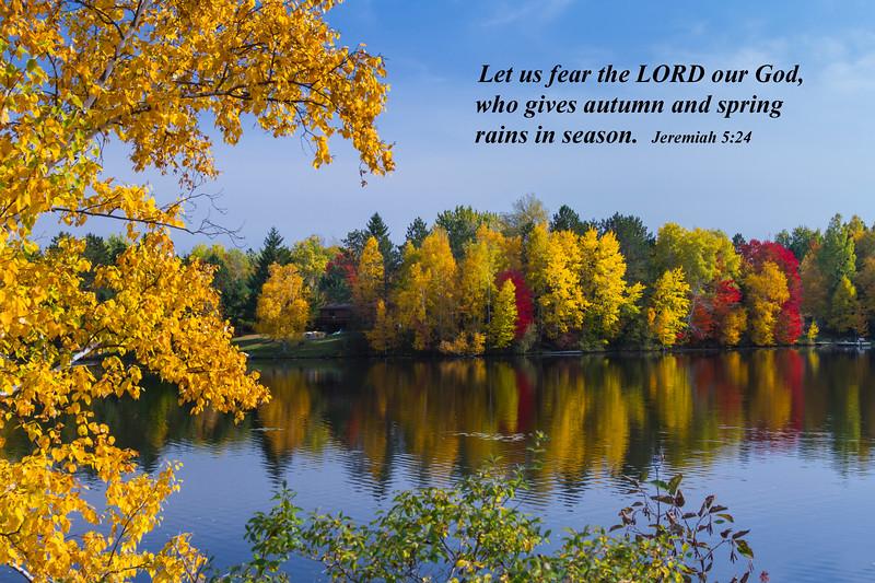 Brilliant fall foliage reflected in Minocqua Lake near Minocqua, Wisconsin, USA.