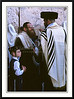 Orthodox Jews in religious dress with a young boy at the Western Wall in Jerusalem, Israel.