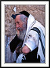An orthodox Jewish man in relgious dress with head tefillin at the Western Wall in Jerusalem, Israel.