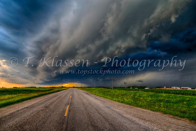Dramatic storm clouds over Highway 23 near Swan Lake, Manitoba, Canada.
