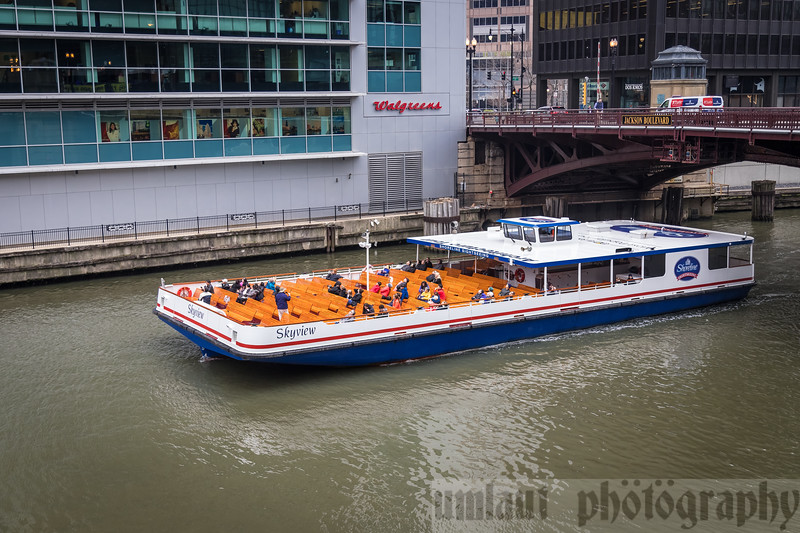 One of MANY sightseeing tour boats along the Chicago river.