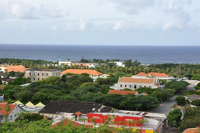 Left quarentine building and right Curaçao museum... background Holiday Beach Hotel