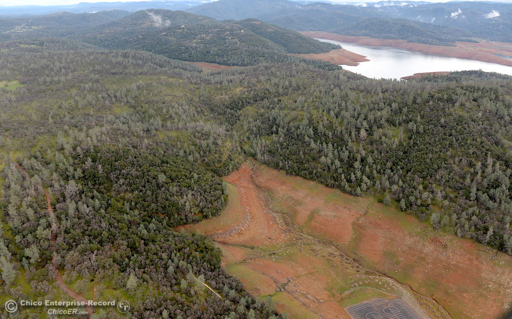 . A dry section of Lake Oroville and the bottom parking lot of the Spillway Launch Facility are seen during a look at the ongoing construction around the spillway and Lake Oroville Dam area Friday Jan. 26, 2018.  Bill Husa -- Enterprise-Record)