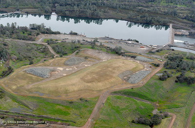 Large piles of rocks and dirt are seen near the Diversion Dam during a look at the ongoing construction around the spillway and Lake Oroville Dam area Friday Jan. 26, 2018.  Bill Husa -- Enterprise-Record)