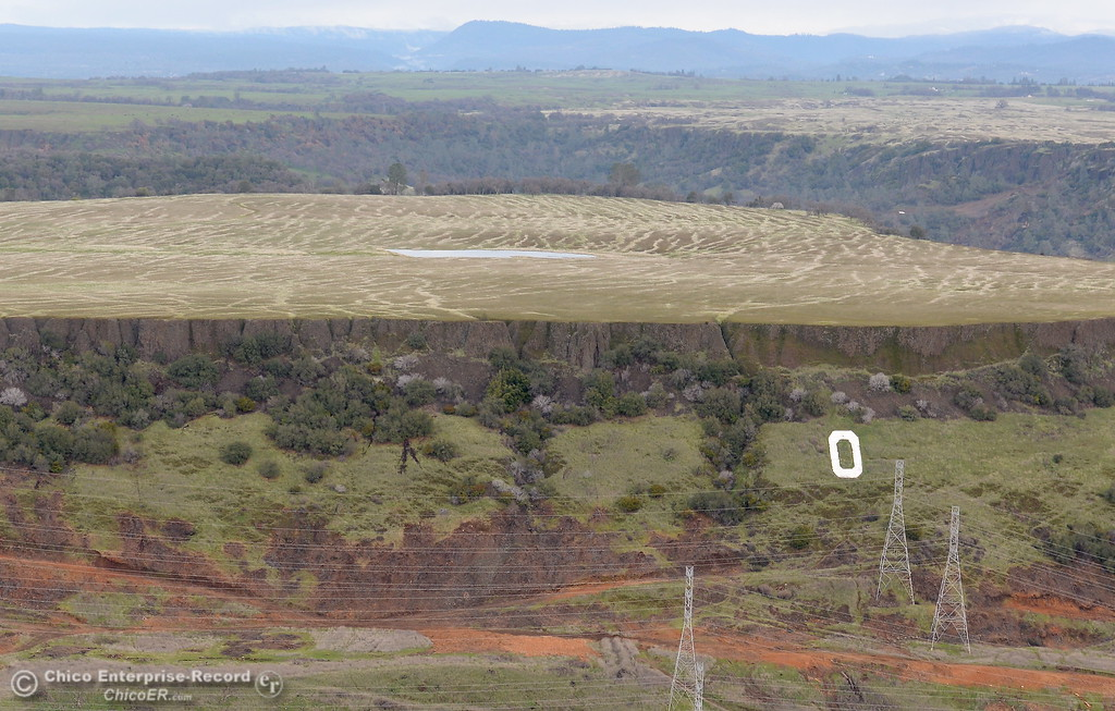 ". The big ""O\"" is seen on the side of a lush green Table Mountain during a look at the ongoing construction around the spillway and Lake Oroville Dam area Friday Jan. 26, 2018.  Bill Husa -- Enterprise-Record)"