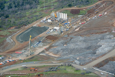 This is an aerial view looking at large piles of dirt, concrete and equipment below the emergency spillway seen during a look at the ongoing construction around the spillway and Lake Oroville Dam area Friday Jan. 26, 2018.  Bill Husa -- Enterprise-Record)