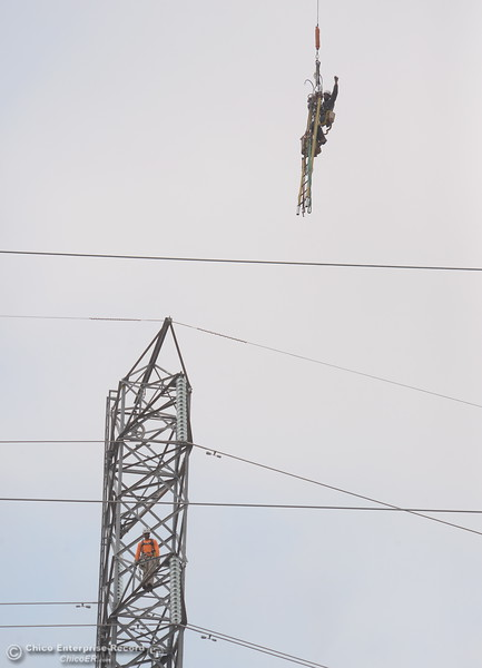 Up, up and away! Fearless PG&E Linemen are plucked from a tower by a helicopter as work continues near the Lake Oroville Dam Spillway in Oroville, Calif. Thursday Sept. 14, 2017. (Bill Husa -- Enterprise-Record)